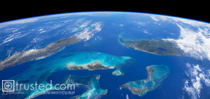 A view from space capturing the never-ending shades of blue and green over the Caribbean.