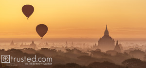 Hot-air balloons rising over the dawn sky at Bagan, Myanmar.